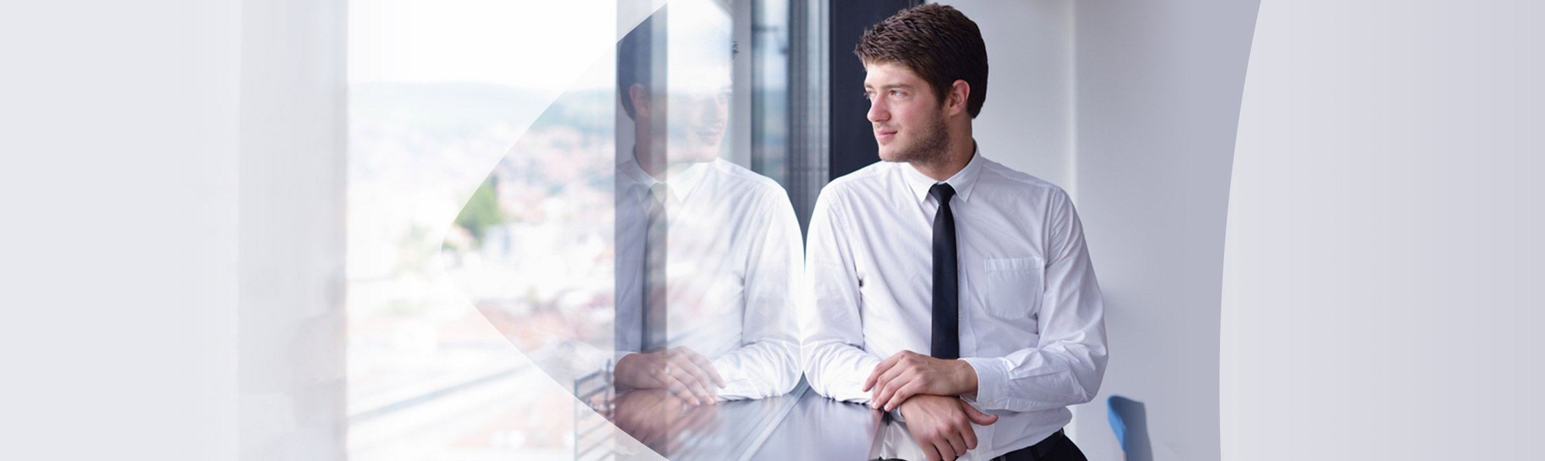 Man in office staring out window